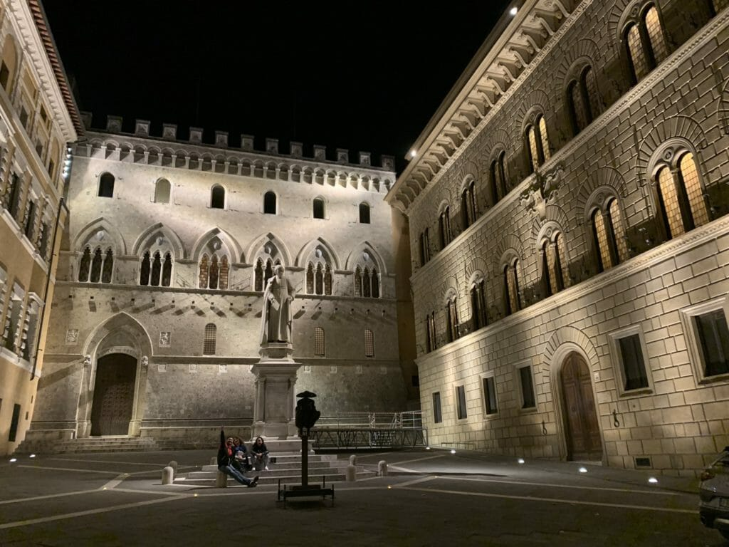 Statue lit up in SIena at midnight