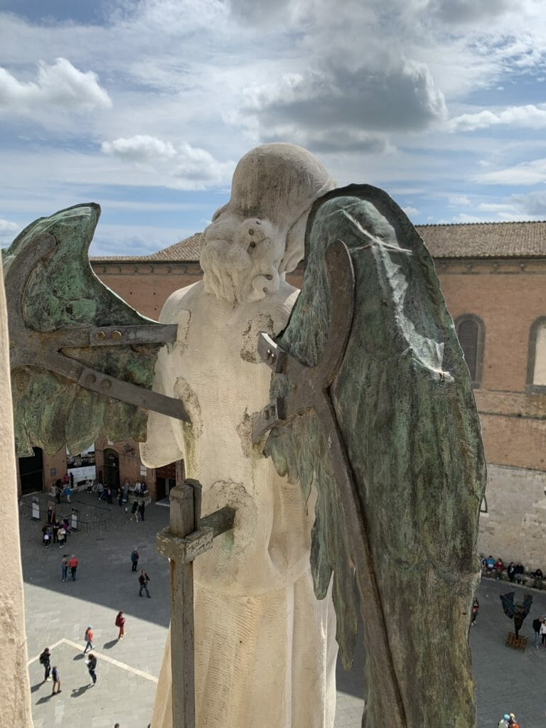 Looking out of the Cathedral facade from behind the angel statue