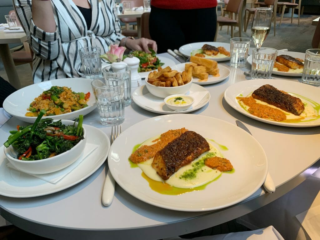 Table full of plates, including the side dishes