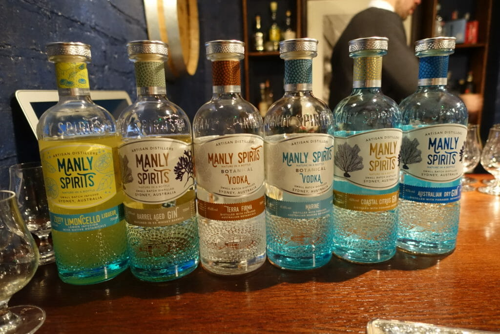 6 bottles of various Manly Spirits products lined up on a bar