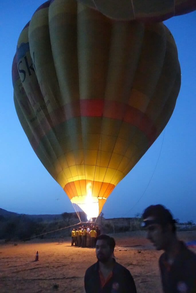 Hot air balloon in the pre-dawn light with the burners going