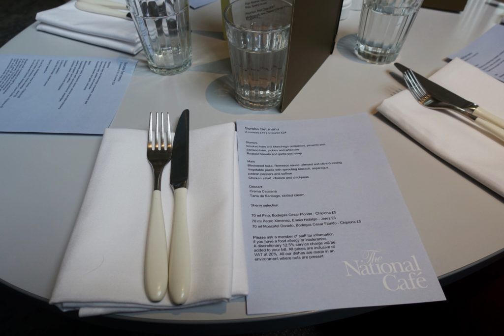 Menu on the table with knife and fork
