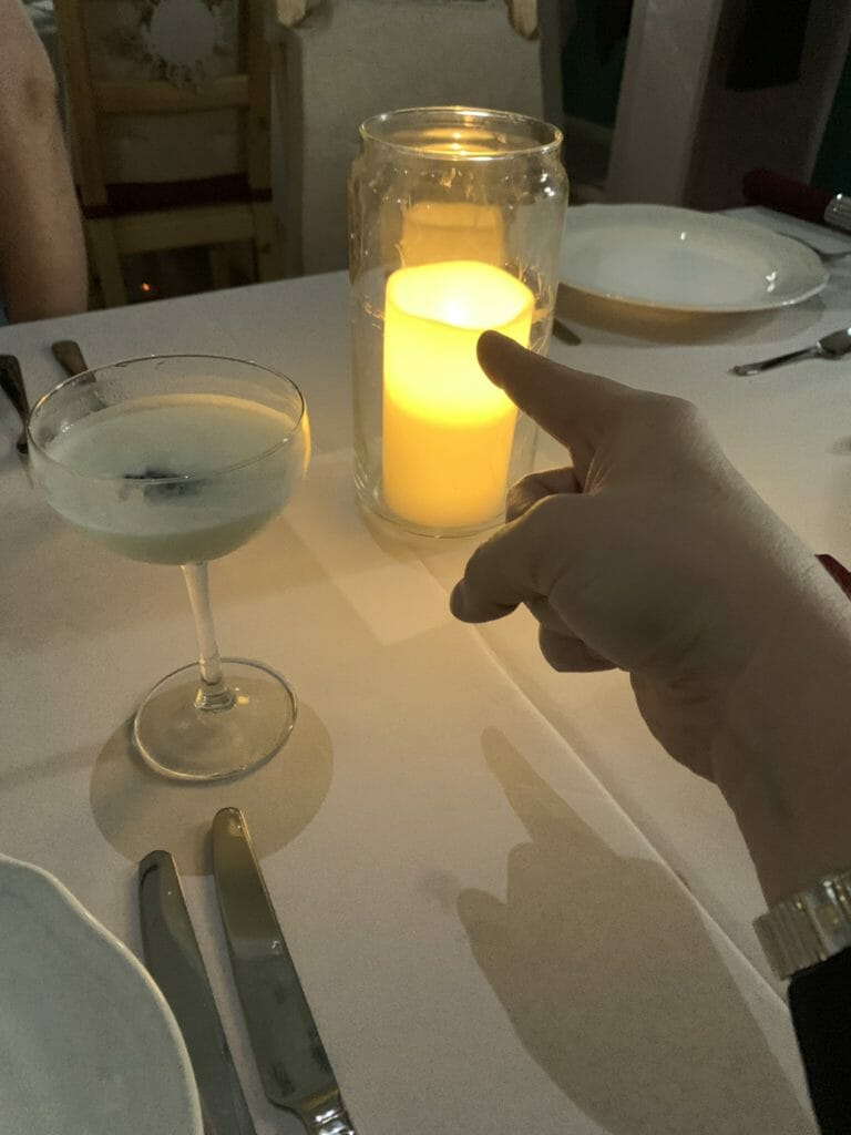 Katie's finger pointing at a electronic candle