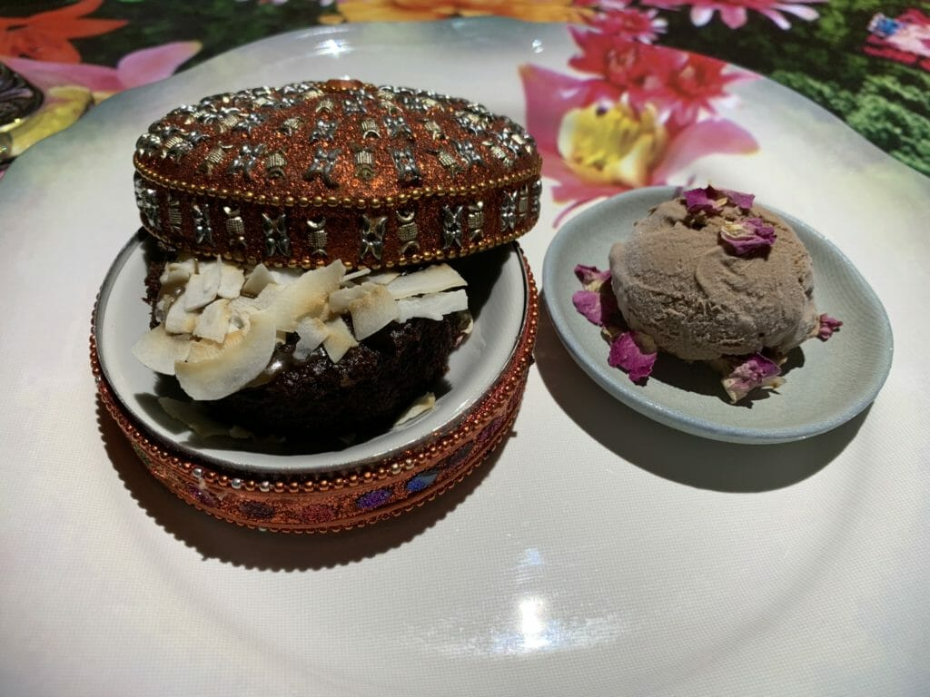 Jewelled box holding the chocolate dessert with sorbet in a bowl next to it