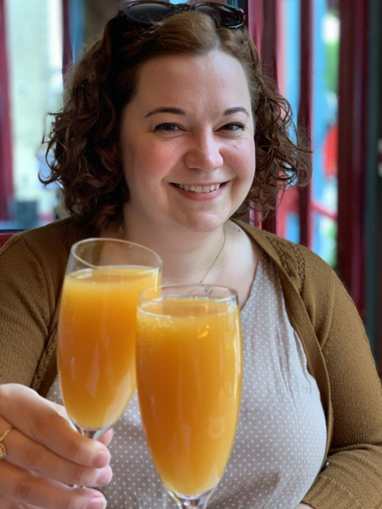 Cheers-ing mimosa glasses with Becky