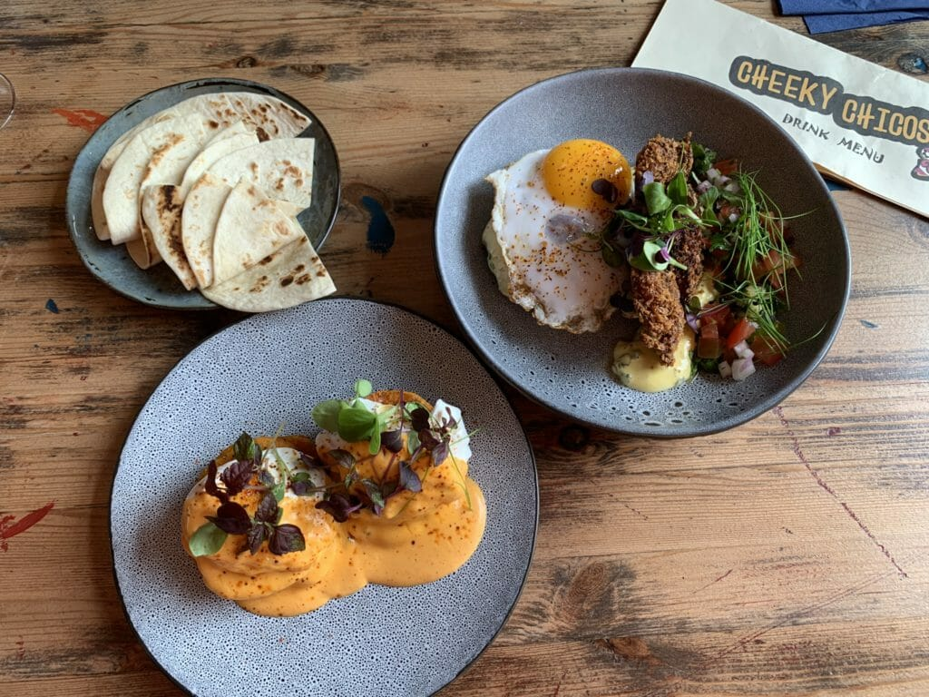 Brunch dishes and extra corn toirtillas at Cheeky Chicos