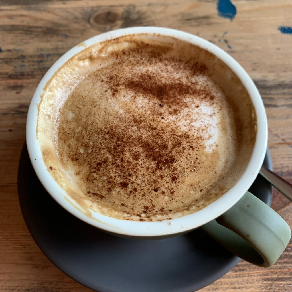 Close up of coffee cup with steamed milk