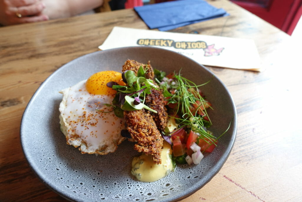 Fried egg and deep fried soft-shell crab with salsa, green hollandaise and micro herbs
