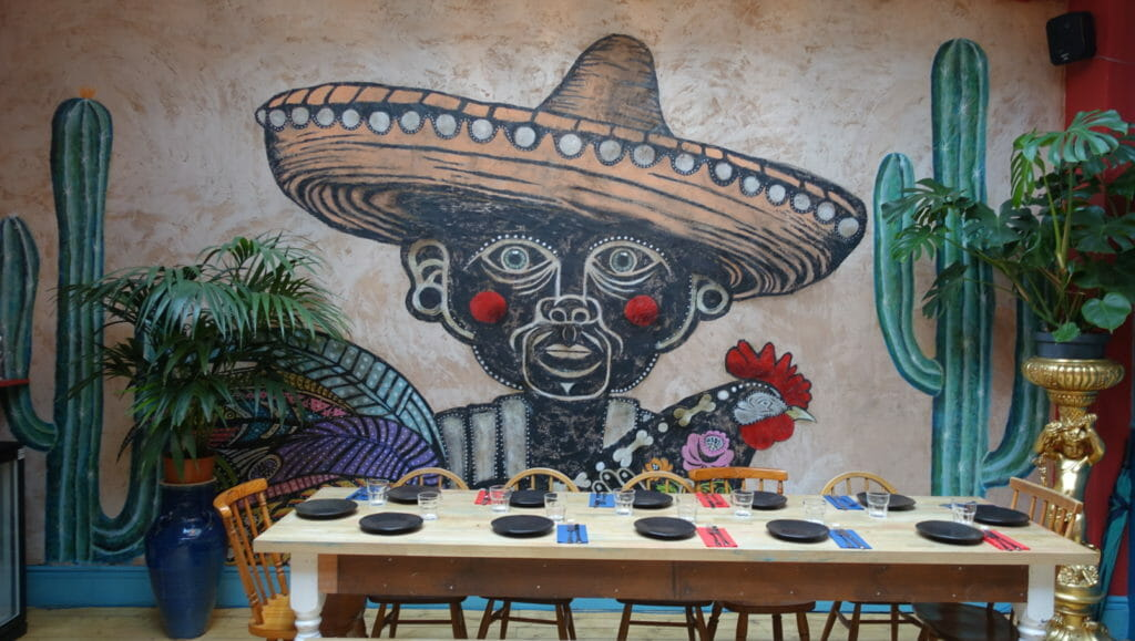 Mural of a man in a wide brimmed sombrero and cactus