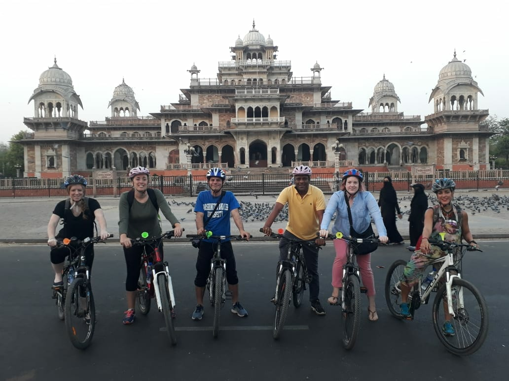 The group on bikes in front of the palace in Jaipur