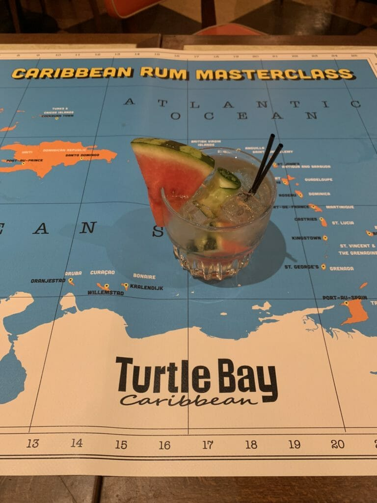 Caribbean rum masterclass map of the islands with welcome drink on top