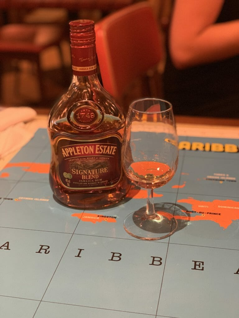 Appleton Estate rum bottle on Caribbean map