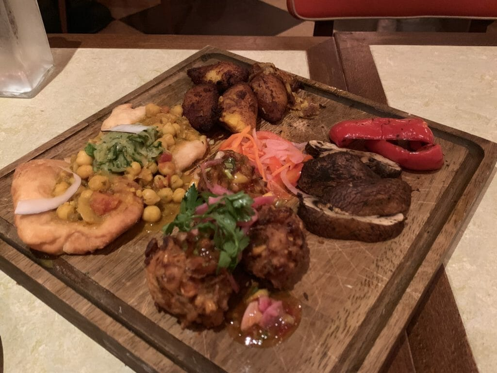 Wooden platter of vegan foodies