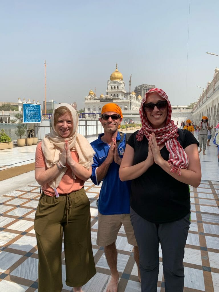 The group with scarfs or bandannas to cover their heads at the Sikh temple in Delhi