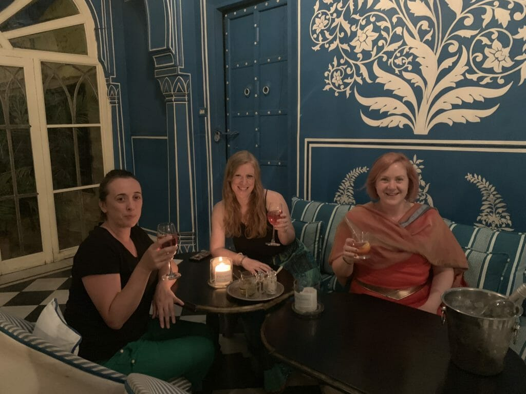 The girls toasting with drinks at dinner