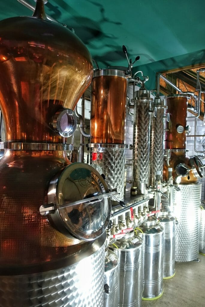 Vertical shot of the three stills at City of London distillery