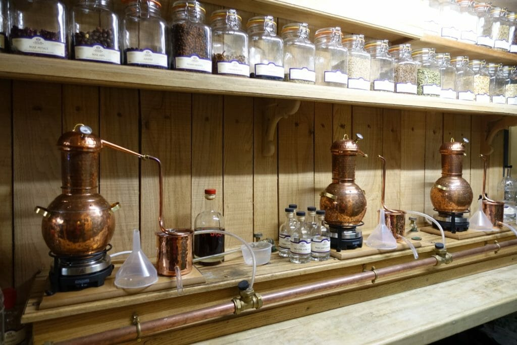 The gin lab with miniature stills and glass jars of botanicals