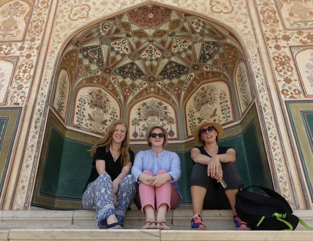 The girls posing in a niche at the Amer Fort in Jaipur