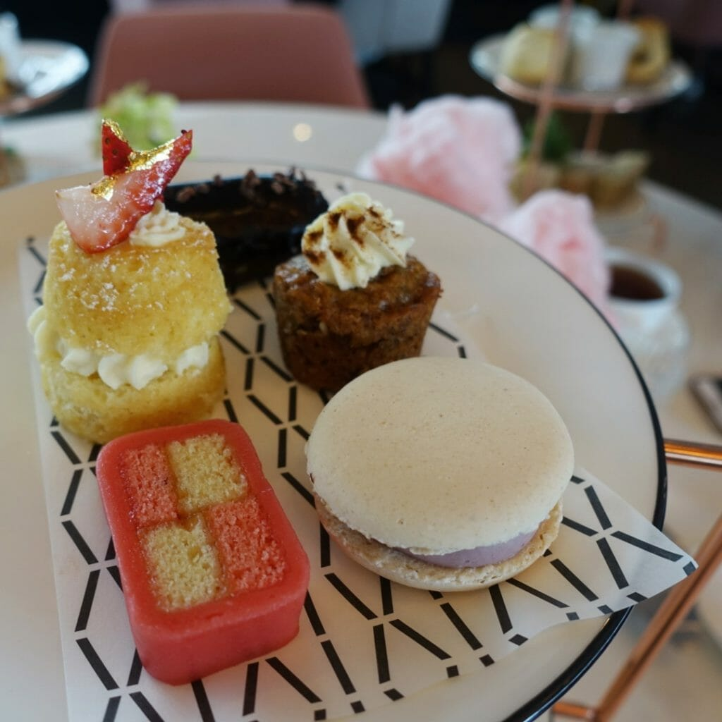 Plate of tiny cakes and other sweet treats