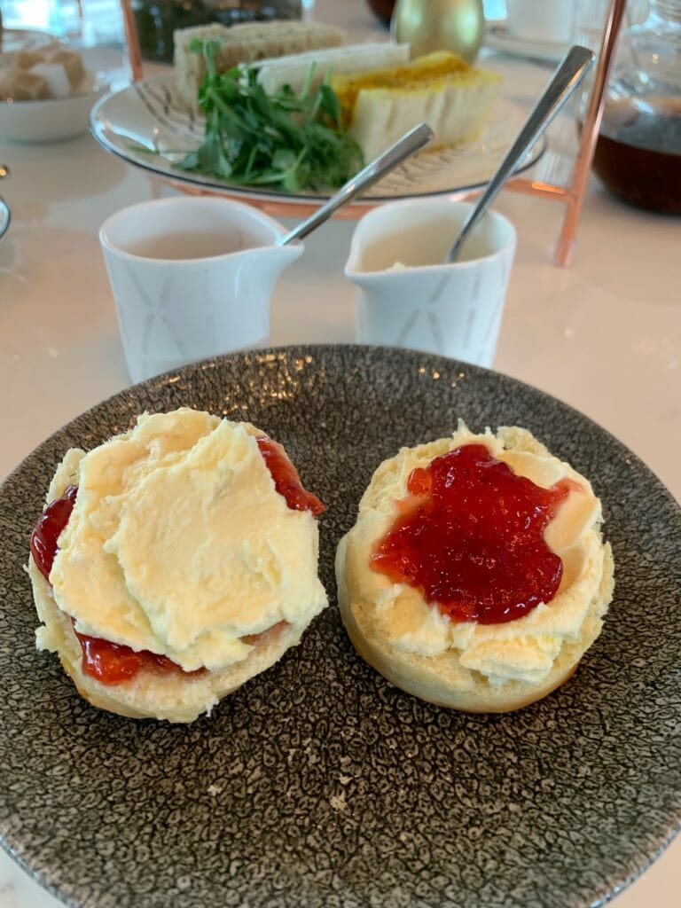 Scones with jam and cream on them