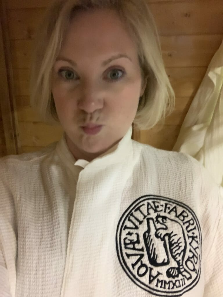 Katie in robe inside the sauna