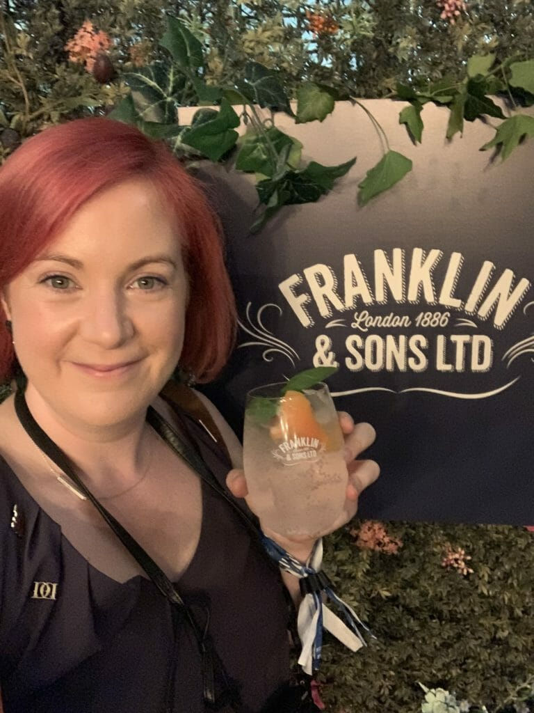 Katie with G&T by the Franklin & Sons Ltd sign
