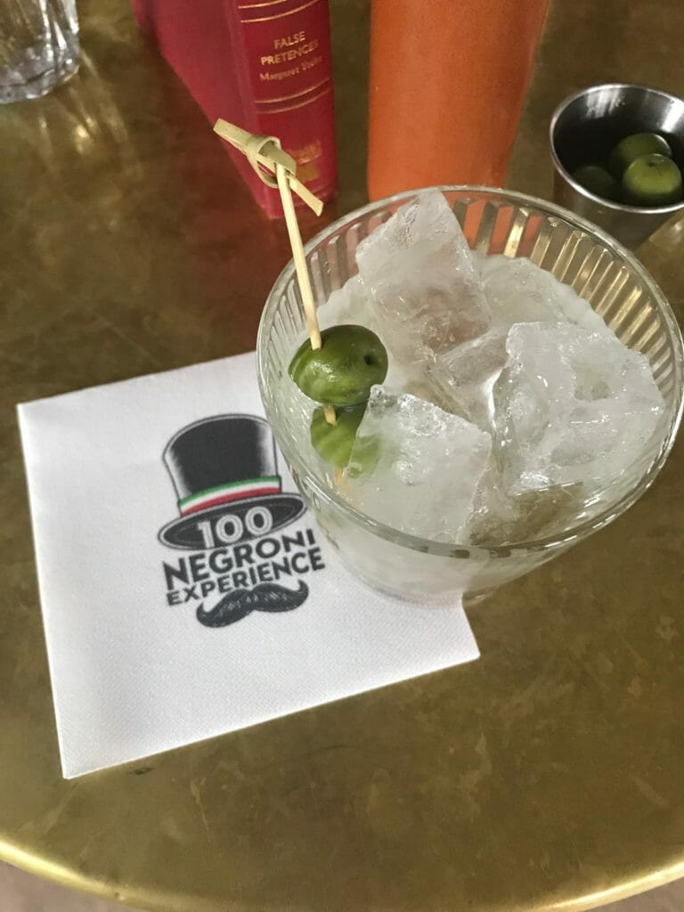 White negroni with olives and 100 Negroni Experience napkin