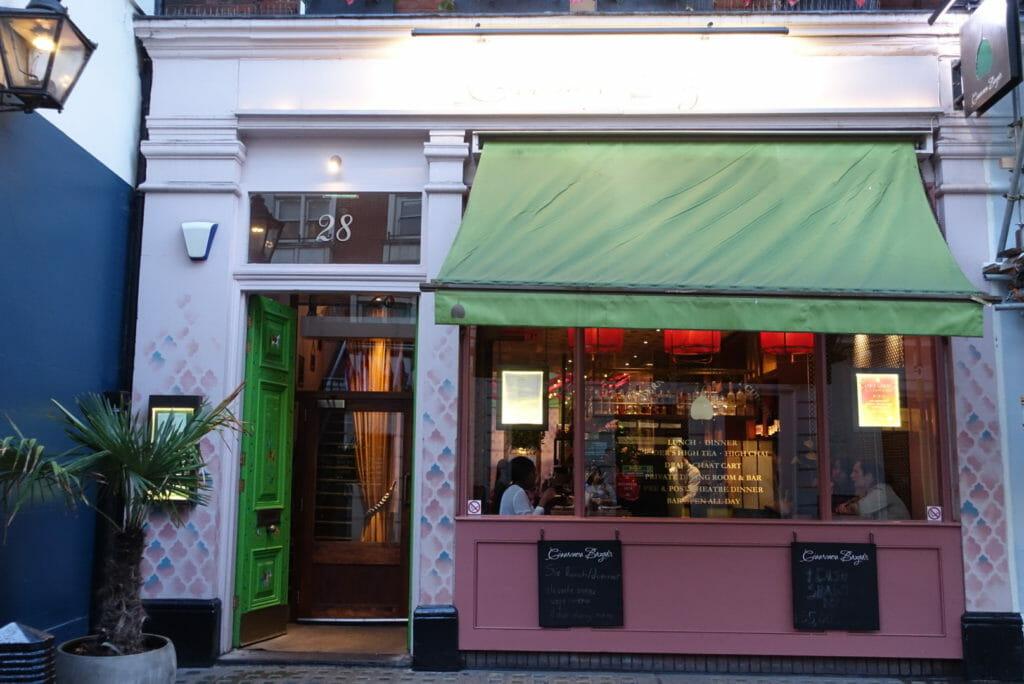 Green door entrance way into the restaurant