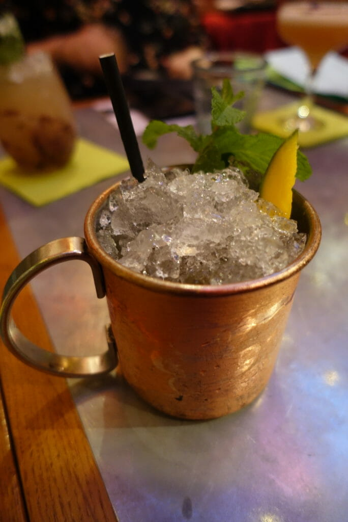 Julep cup with mint and mango poking out of the ice