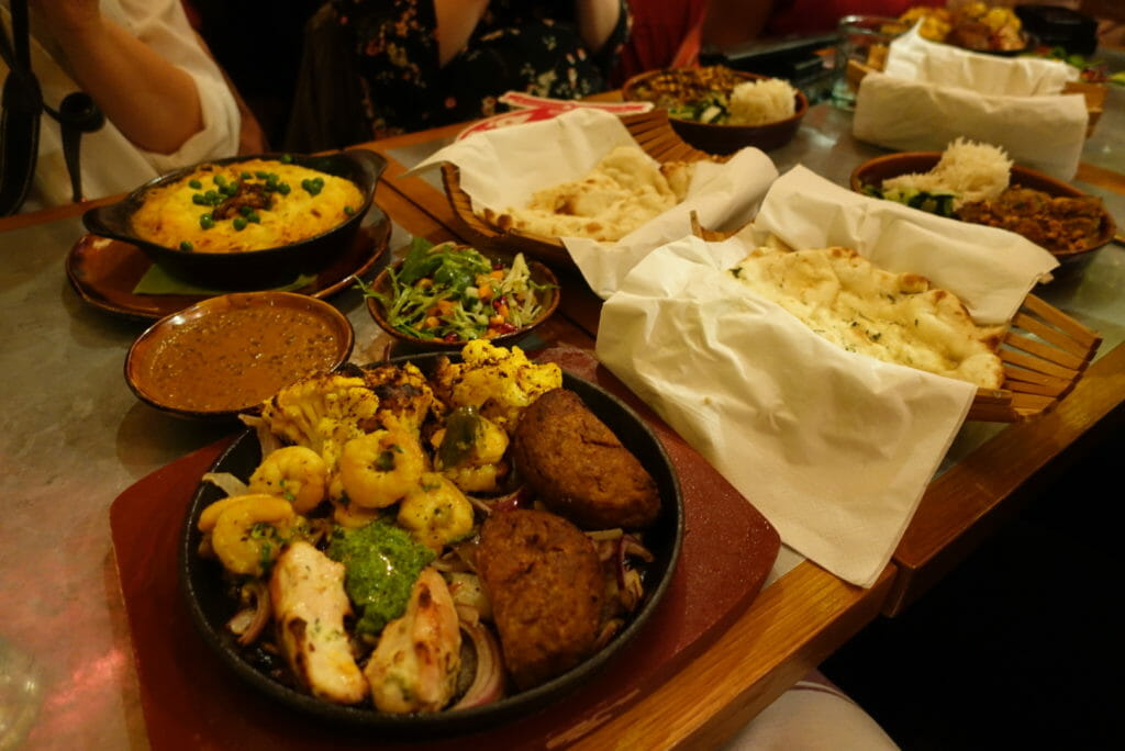 The table filled with main dishes and breads