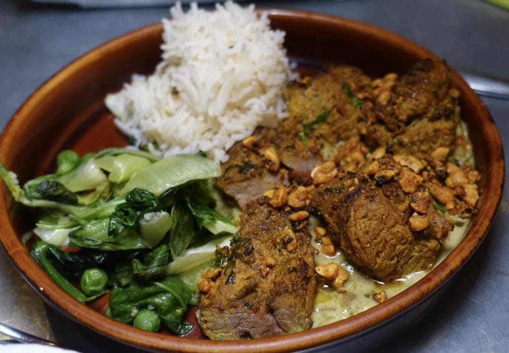 Lamb with greens and pilau rice