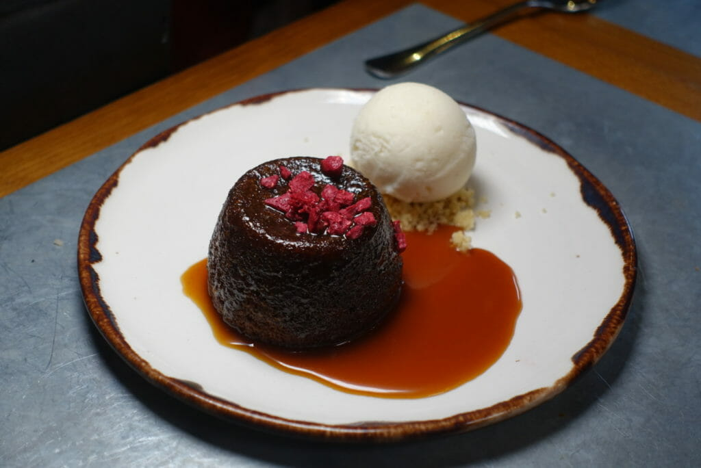 Sticky carrot and ginger toffee pudding with ice cream