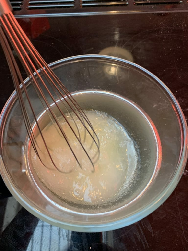 Whisking the egg whites on the stove