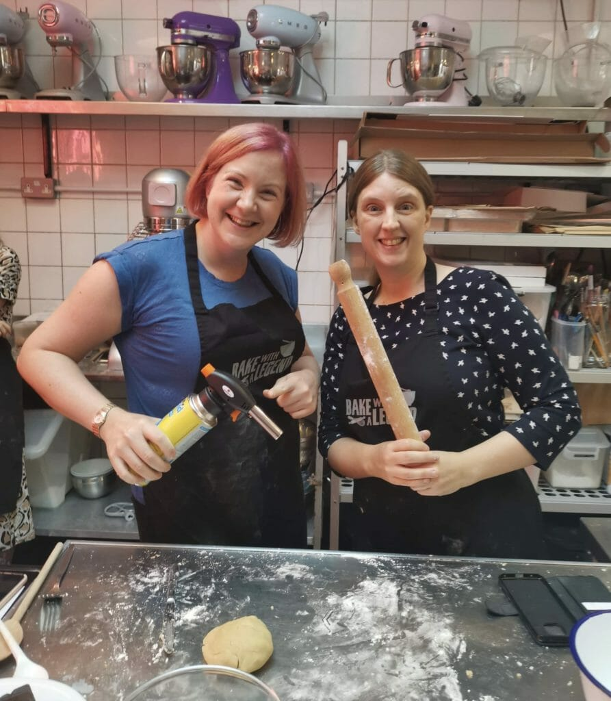 Katie and Jo with rolling pin and blow torch