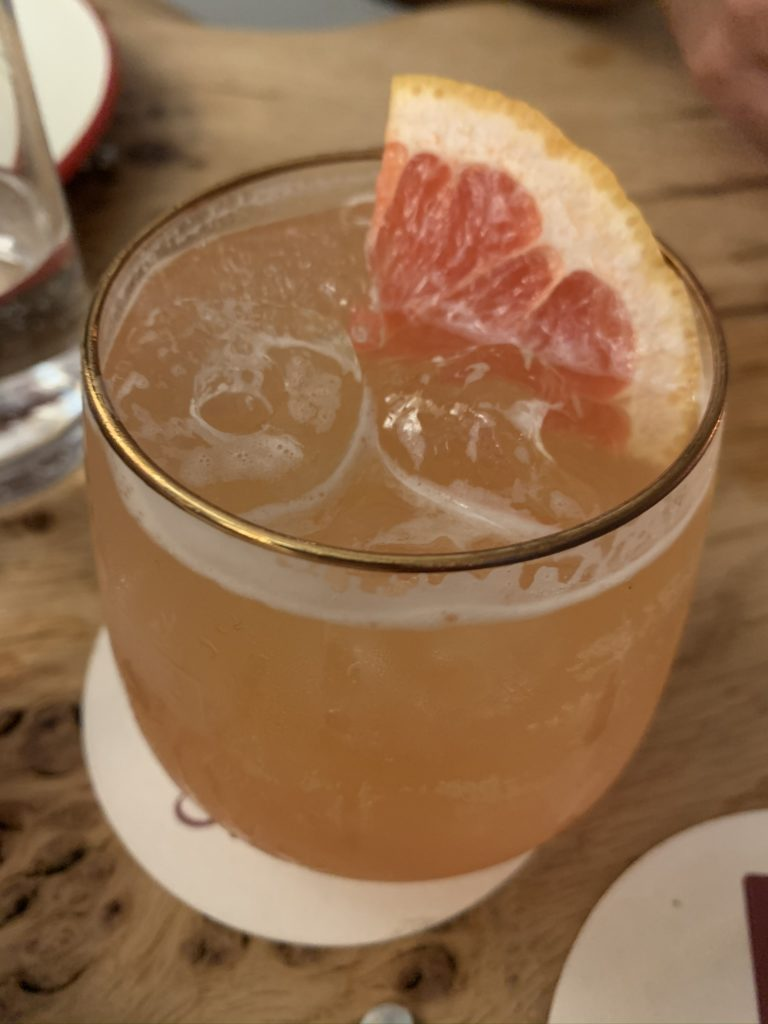 Drambuie cocktail with pink grapefruit garnish