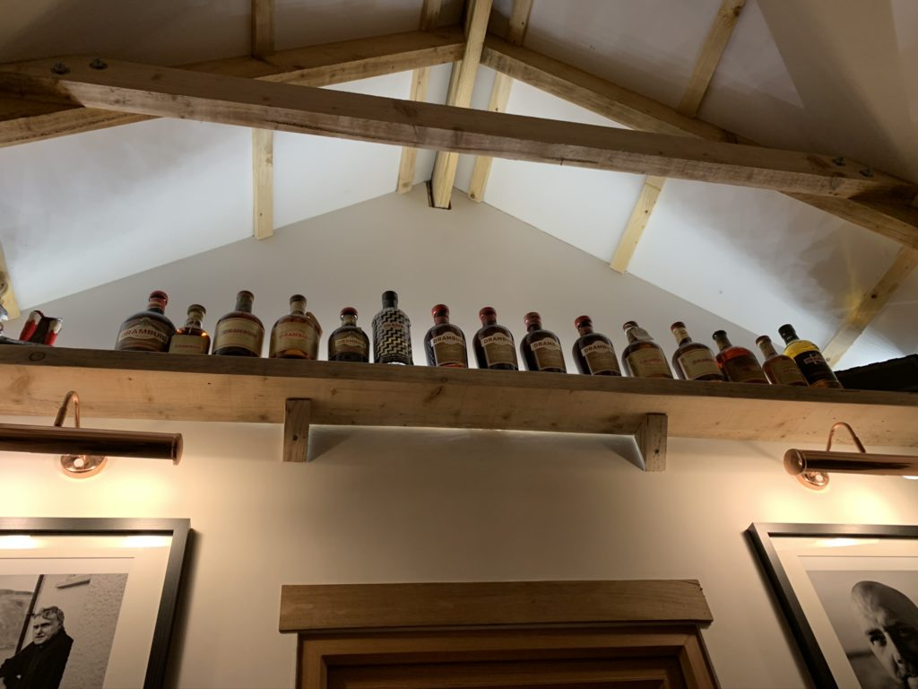 Drambuie bottles lined up in the eaves of the Skye Bothy