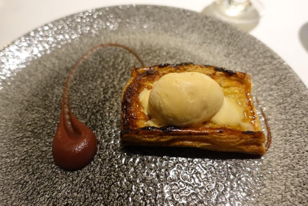 Apple tart with ice cream on top