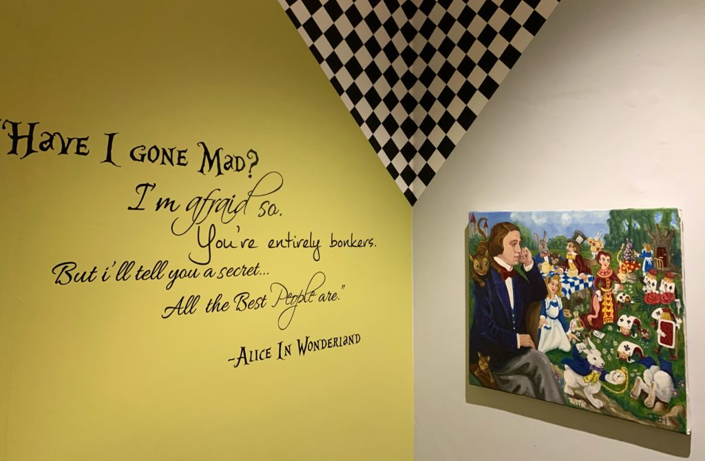 Quote from Alice in Wonderland on the wall