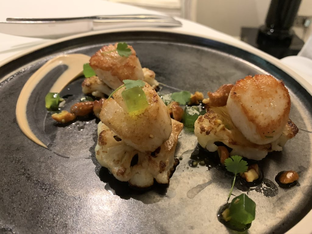 Scallops sat on top of cauliflower slices