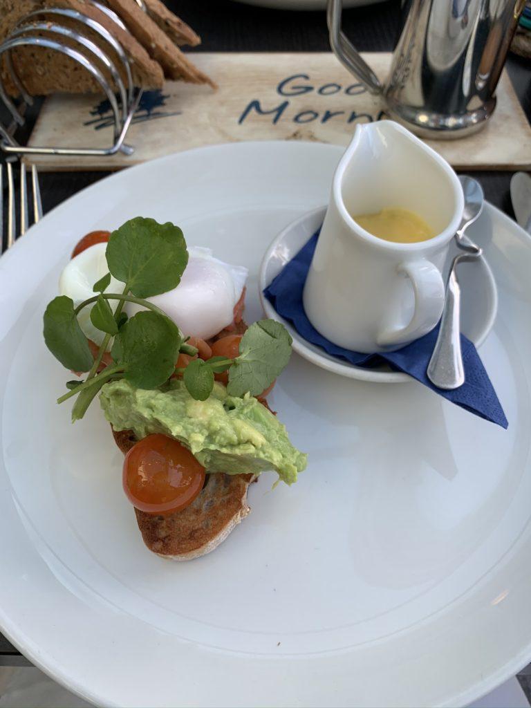 Avocado toast and jug of hollandaise sauce