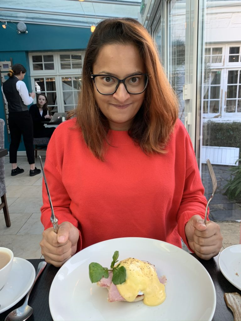 Eggs Benedict and Meena defending them with knife and fork