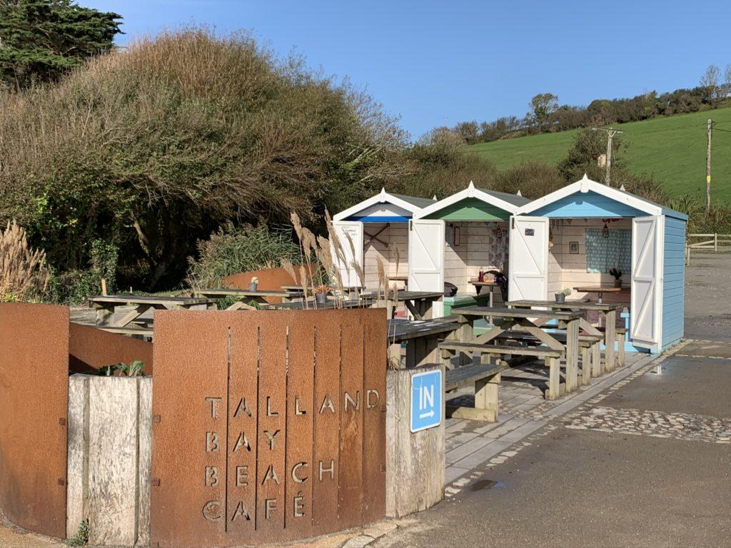 Talland Bayu Beach Cafe with little huts