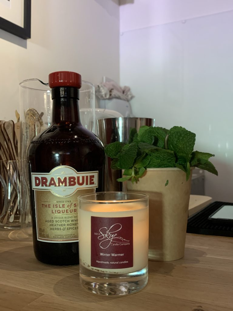 Drambuie bottle by candle and mint
