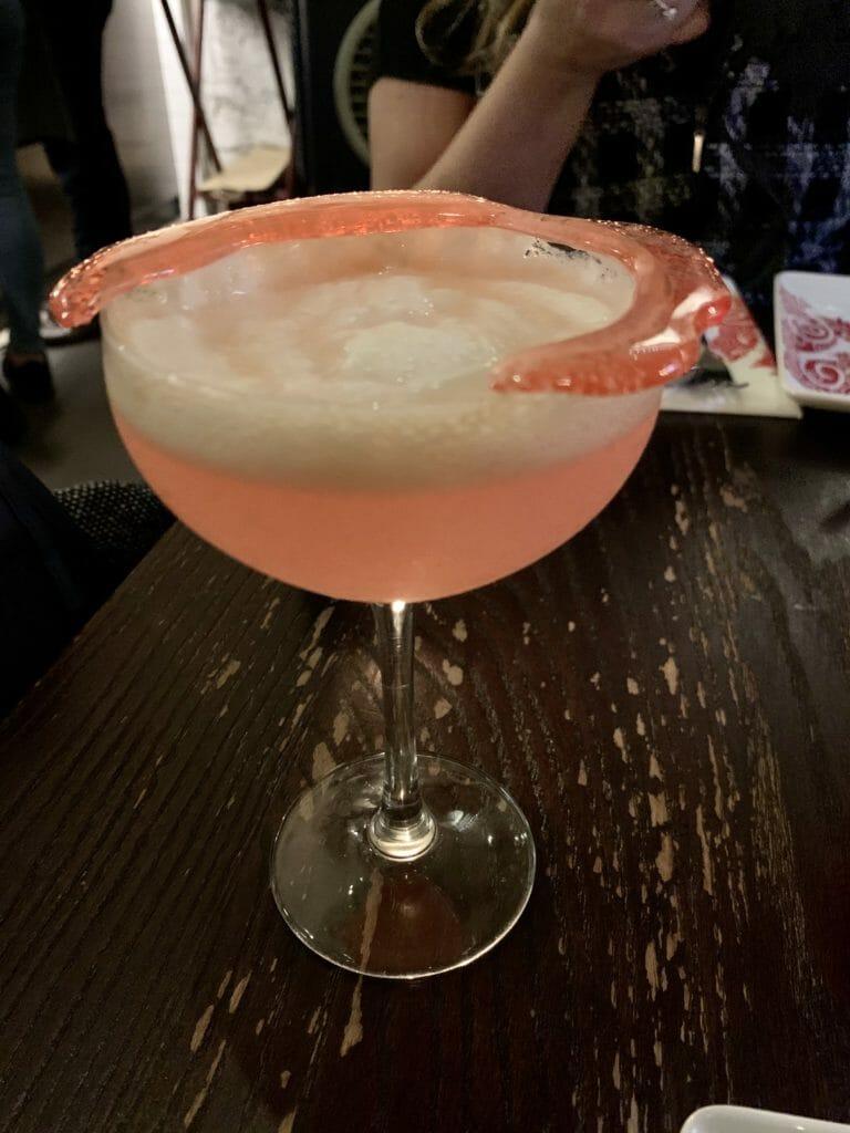 Pink cocktail with sugar garnish