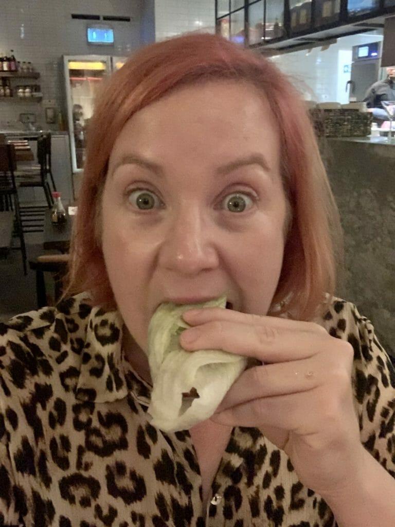 Katie eating lettuce wrap