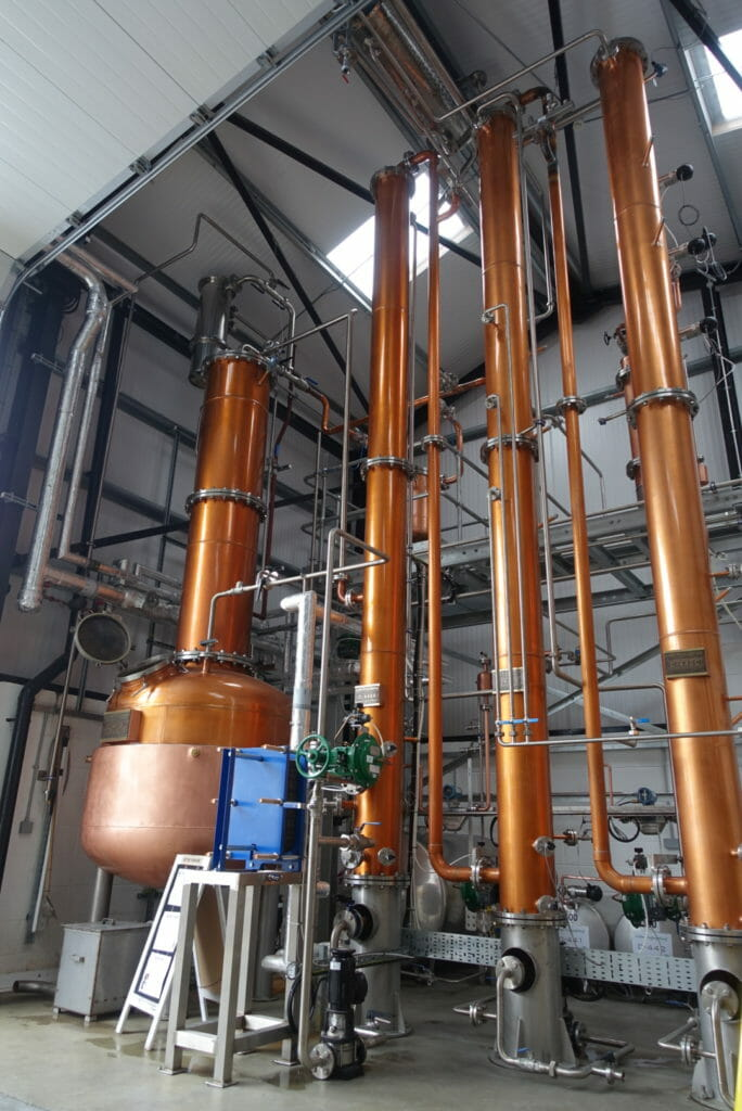 The tall column stills at Doghouse Distillery