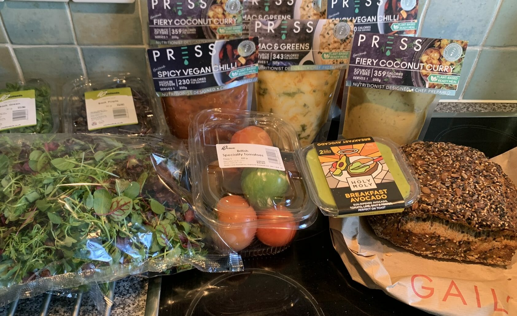 A selection of salad, bread and vegan meals from Press