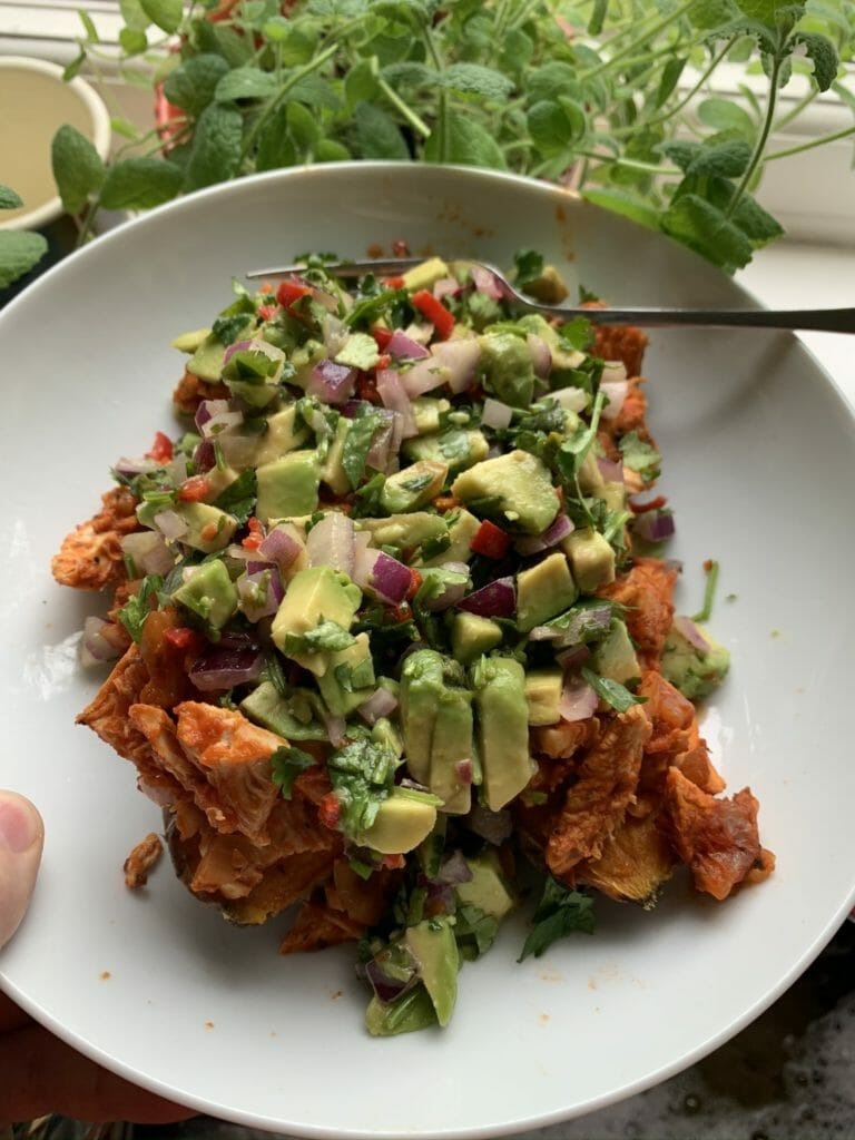 Chipotle chicken on sweet potato with avocado salsa