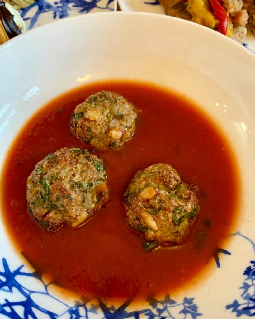 Meatballs sat in a bowl of tomato house