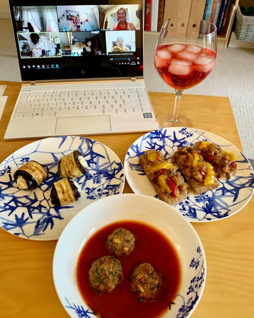 Aperitivo dishes in front of the laptop